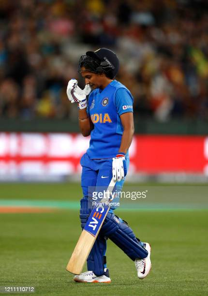 Harmanpreet Kaur of India looks dejected after being dismissed by Jess Jonassen of Australia during the ICC Women's T20 Cricket World Cup Final match...