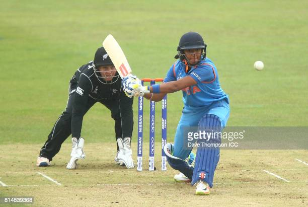 Harmanpreet Kaur of India plays a shot off in from of Rachel Priest of New Zealand during the ICC Women's World Cup match between India and New...