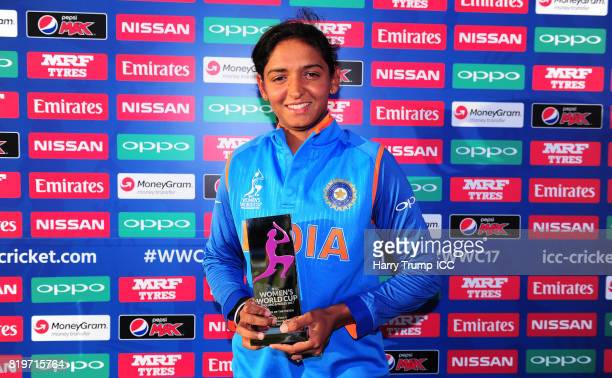 Harmanpreet Kaur of India poses with the player of the match award during the ICC Women's World Cup 2017 match between Australia and India at The...