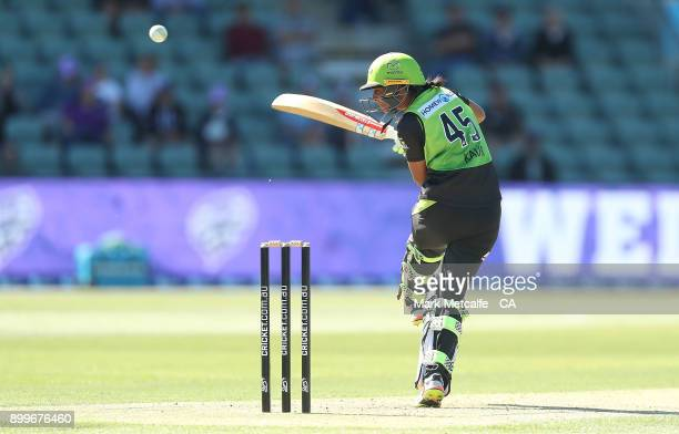 Harmanpreet Kaur of the Thunder avoids a delivery during the Women's Big Bash League match between the Hobart Hurricanes and the Sydney Thunder at...