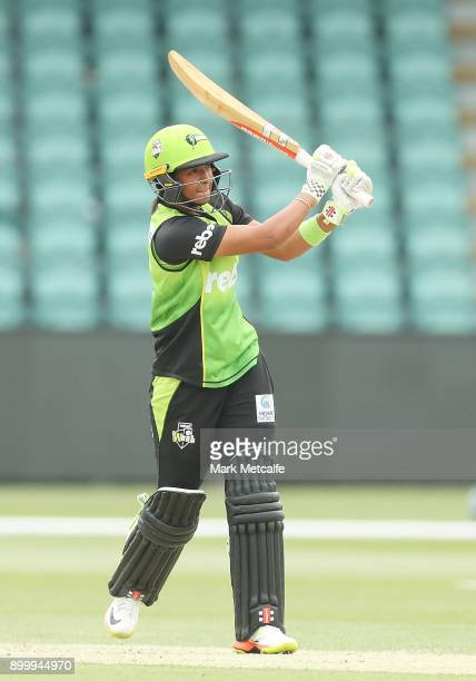 Harmanpreet Kaur of the Thunder bats during the Women's Big Bash League match between the Sydney Thunder and the Hobart Hurricanes at the University...