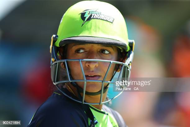 Harmanpreet Kaur of the Thunder looks on while waiting to bat during the Women's Big Bash League match between the Perth Scorchers and the Sydney...