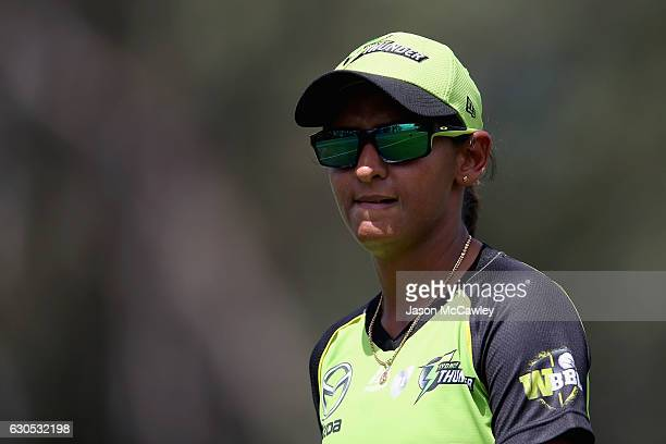 Harmanpreet Kaur of the Thunder watches on during the WBBL match between the Melbourne Renegades and Sydney Thunder at Blacktown International...