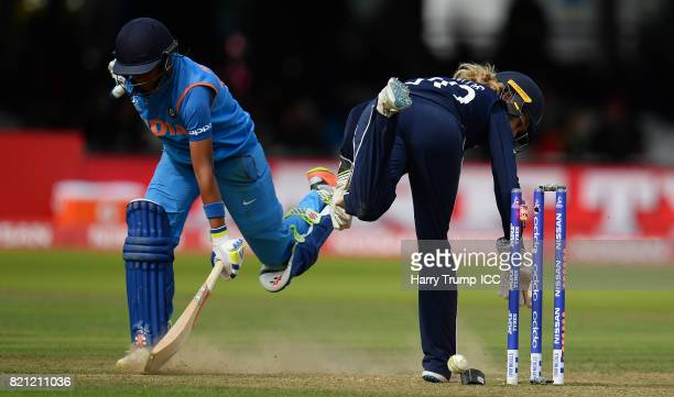 Harmanpreet Kaut of India survives a run out chance during the ICC Women's World Cup 2017 Final between England and India at Lord's Cricket Ground on...