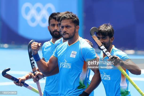 Harmanpreet Singh celebrates scoring the first goal with Sumit and teammates during the Men's Semifinal match between India and Belgium on day eleven...