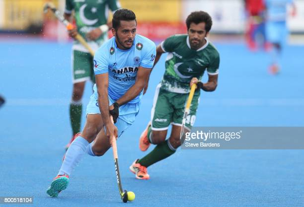Harmanpreet Singh of India runs with the ball during the 5th8th place match between Pakistan and India on day eight of the Hero Hockey World League...