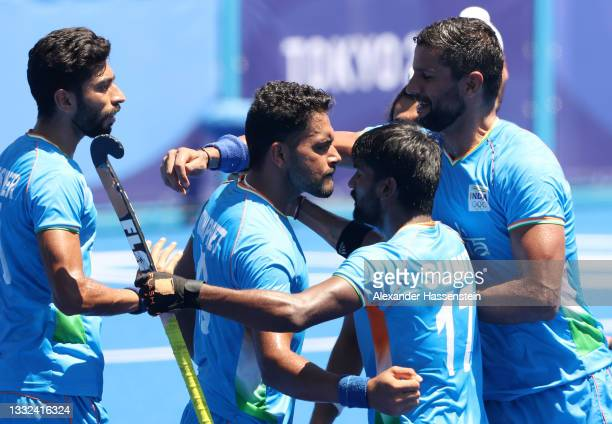 Harmanpreet Singh of Team India celebrates scoring their third goal with teammates during the Men's Bronze medal match between Germany and India on...