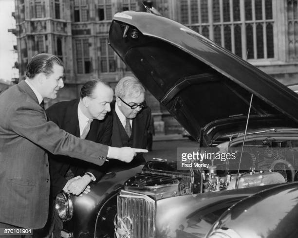 Harmar Nicholls the MP for Peterborough demonstrates his dieselengine saloon car to George Edward Peter Thorneycroft President of the Board of Trade...