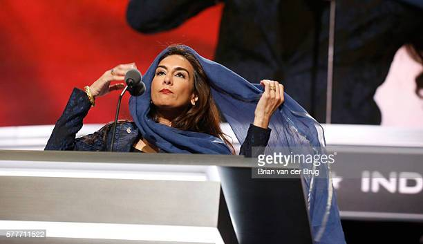 Harmeet Dhillon covers her hair as she conducts the invocation during the second day of the Republican National Convention in Cleveland Tuesday July...