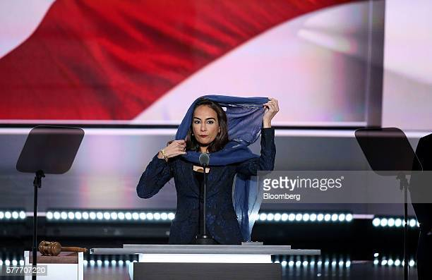 Harmeet Dhillon vice chair of the Republican Party of California puts on a head scarf while speaking during the Republican National Convention in...