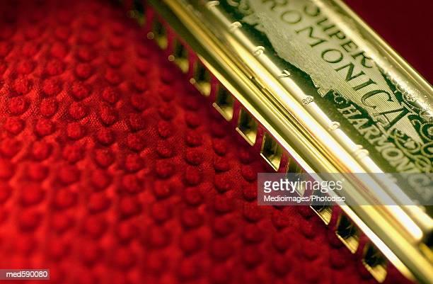 Harmonica on red cloth