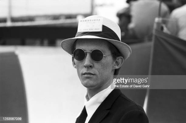 Harmonicist musician and writer Mel Lyman poses for a portrait at backstage at the Newport Folk Festival in July 1965 in Newport Rhode Island Mel...