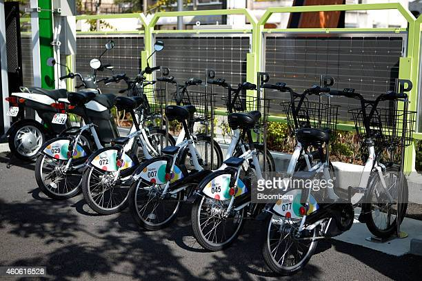 Harmonious Mobility Network known as Hamo electrically powerassisted bicycles manufactured by Yamaha Motor Corp stand at a Smart Mobility Park...