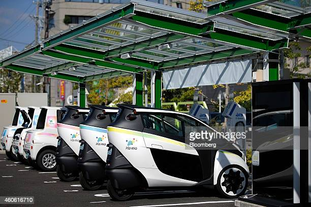 Harmonious Mobility Network known as 'Hamo' Toyota Motor Corp iRoad electric personal mobility vehicles front stand at a Smart Mobility Park electric...