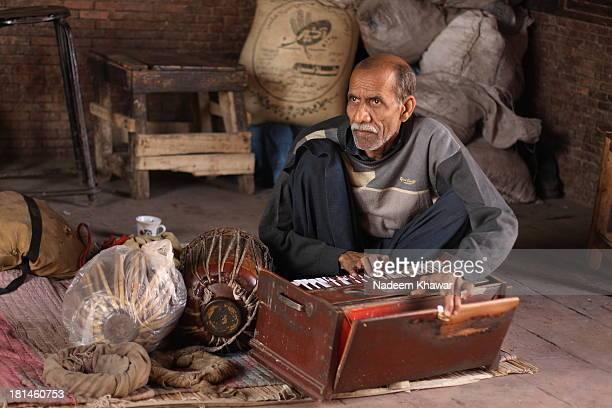 Harmonium Player at The Tomb of Shah Ruknr Alim Multan
