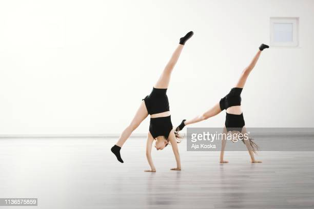 harmonized cartwheel. - gymnastics stock pictures, royalty-free photos & images