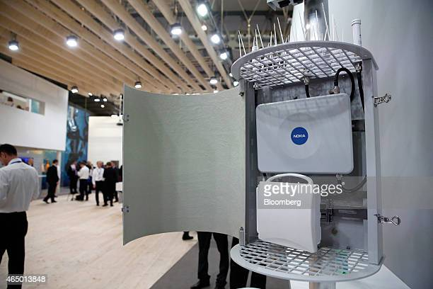 A Harmony Lite outdoor digital network device manufactured by Nokia Solutions and Networks sits on display in the Nokia Oyj pavilion at the Mobile...