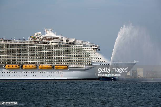 Harmony Of The Seas The Worlds' Largest Cruise Ship Gets a Traditional Water Spray Send Off From Tug Lomax on Southampton Water In Southern England Uk