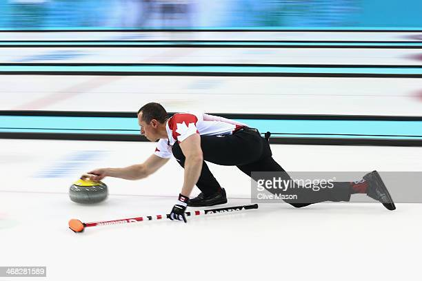 Harnden of Canada in action during the round robin match against Germany during day 3 of the Sochi 2014 Winter Olympics at Ice Cube Curling Center on...