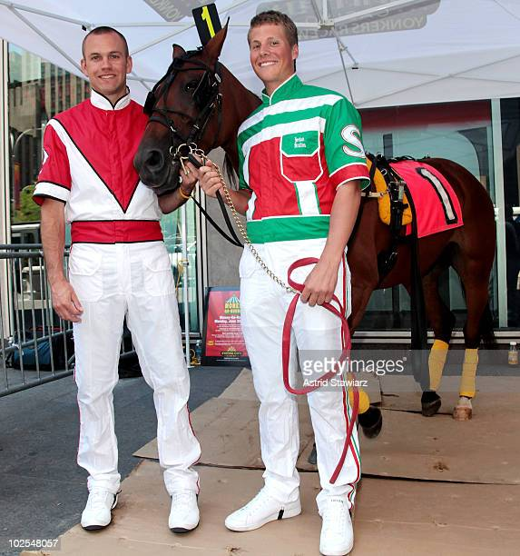 Harness racing drivers Jason Bartlett and Jordan Stratton pose for photos with the talking horse from the Empire City Casino outside News Corp...