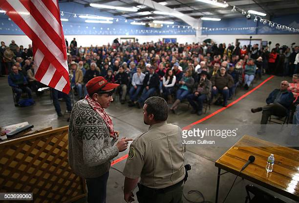 Harney County Sheriff David Ward talks with a resident during a community meeting at the Harney County fairground on January 6 2016 in Burns Oregon...
