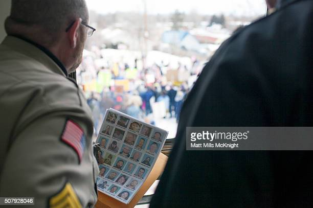 Harney County Sheriff holds a list of possible people to question while looking out the Harney County Courthouse window on February 1 2016 in Burns...