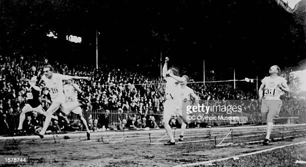 Harold Abrahams of Great Britain crosses the line to win the 100 metres from Jackson Scholz of the US and Arthur Porritt of New Zealand at the 1924...