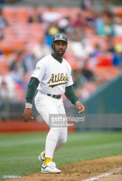 Harold Baines of the Oakland Athletics leads off of third base during an Major League Baseball game circa 1992 at the OaklandAlameda County Coliseum...
