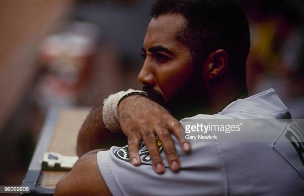 Harold Baines of the Oakland Athletics looks on during a game in the 1991 season against the California Angels at Anaheim Stadium in Anaheim...