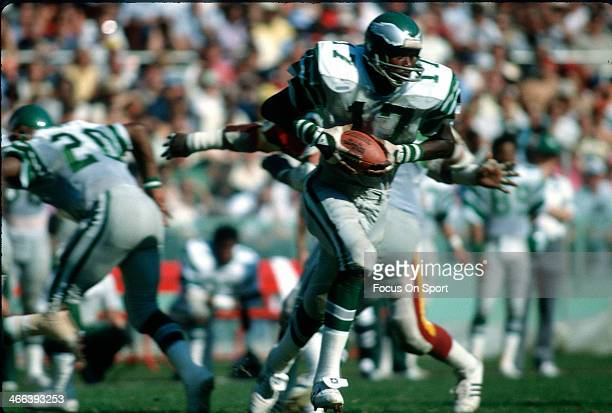 Harold Carmichael of the Philadelphia Eagles carries the ball against the Washington Redskins during an NFL football game circa 1973 at RFK Stadium...