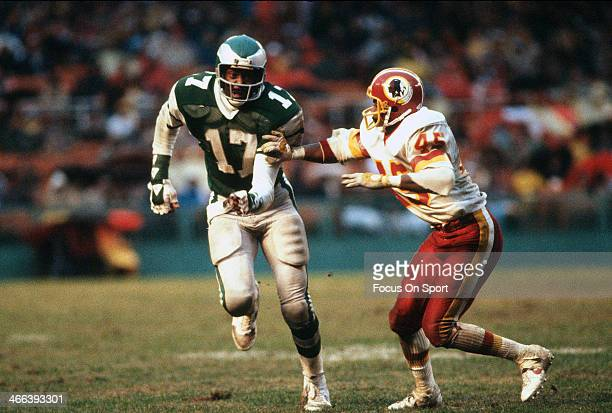 Harold Carmichael of the Philadelphia Eagles carries the ball against the Washington Redskins during an NFL football game circa 1974 at RFK Stadium...
