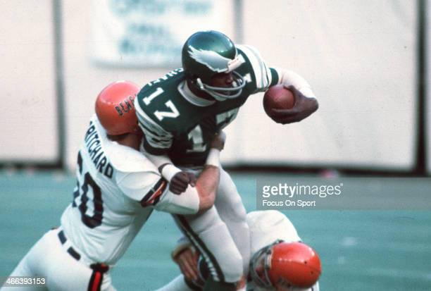 Harold Carmichael of the Philadelphia Eagles gets tackled by Ron Pritchard of the Cincinnati Bengals during an NFL football game December 7 1975 at...