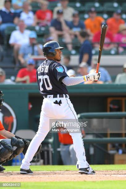 Harold Castro of the Detroit Tigers bats during the Spring Training game against the Miami Marlins at Publix Field at Joker Marchant Stadium on March...