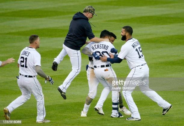 Harold Castro of the Detroit Tigers celebrates with JaCoby Jones, Jake Rogers, Willi Castro and Nomar Mazara after hitting a walk-off single during...