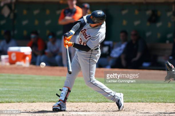 Harold Castro of the Detroit Tigers hits a two-run single in the top of the sixth inning against the Oakland Athletics at RingCentral Coliseum on...