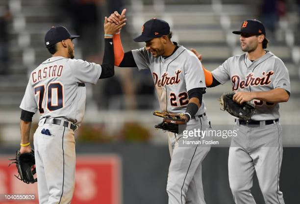 Harold Castro Victor Reyes and Pete Kozma of the Detroit Tigers celebrate defeating the Minnesota Twins 42 on September 25 2018 at Target Field in...