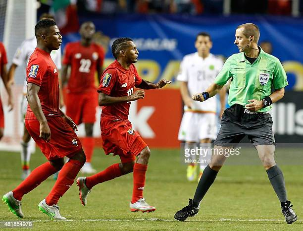 Harold Cummings and Alberto Quintero of Panama rush at referee Mark Geiger after the 2015 CONCACAF Gold Cup semifinal match against Mexico at Georgia...