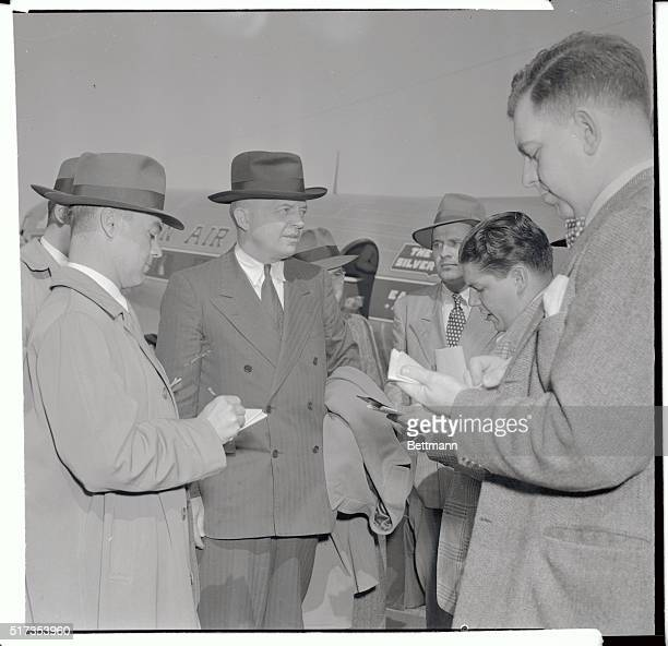 Harold E Stassen GOP Presidential candidate arriving at National Airport to attend the Gridiron Dinner is interviewed by reporters He declined to...