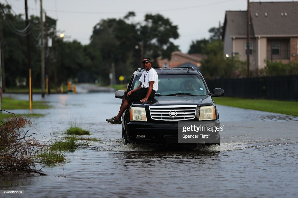 Harold Fergenson grabs a ride through high water along a street in Orange as Texas slowly moves toward recovery from the devastation of Hurricane Harvey on September 6, 2017 in Orange, Texas. Almost a week after Hurricane Harvey ravaged parts of the state, some neighborhoods still remained flooded and without electricity. While downtown Houston is returning to business, thousands continue to live in shelters, hotels and other accommodations as they contemplate their future.