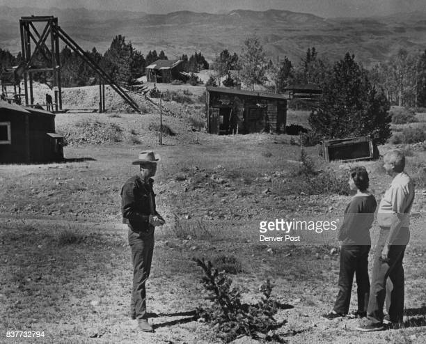 Harold Hern left Cripple Creek businessman guides Mr and Mrs Howard Humphries of Colorado Springs through ghost town of Windy City Free tours include...