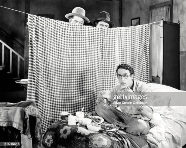 Harold Hickory played by American silent comedy actor Harold Lloyd is watched having his breakfast by his elder brothers Leo and Olin played by Leo...