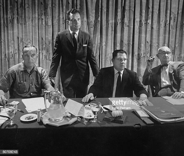 Harold J. Gibbons at a meeting with Edward Bennett Williams , James R. Hoffa and John F. English .