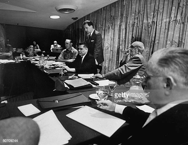 Harold J. Gibbons at a Teamsters meeting with Edward Bennett Williams , James R. Hoffa and John F. English .