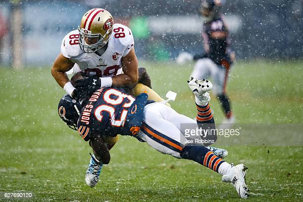 Harold JonesQuartey of the Chicago Bears hits Vance McDonald of the San Francisco 49ers in the second quarter at Soldier Field on December 4 2016 in...