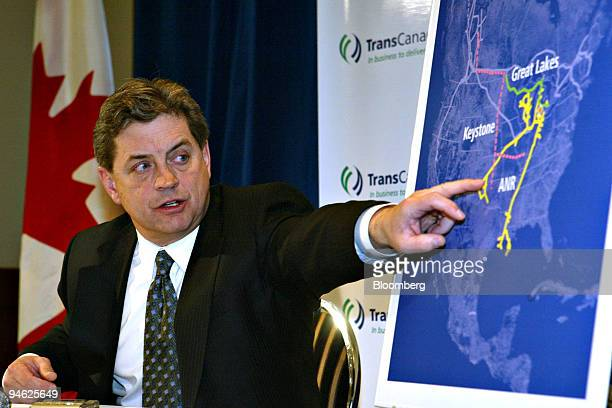 Harold Kvisle president and chief executive officer of TransCanada Corp points to a map of the United States while answering questions during the...