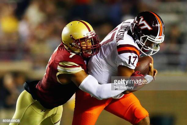 Harold Landry of the Boston College Eagles tackles Josh Jackson of the Virginia Tech Hokies during the first half at Alumni Stadium on October 7 2017...
