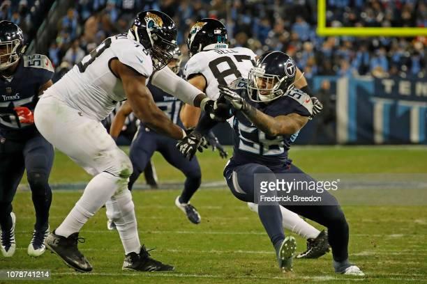 Harold Landry of the Tennessee Titans rushes against Jermey Parnell of the Jacksonville Jaguars at Nissan Stadium on December 6 2018 in Nashville...