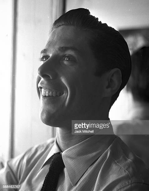 """Harold Lang star of the Broadway hit """"Pal Joey"""" photographed backstage in his dressing room in August 1952."""