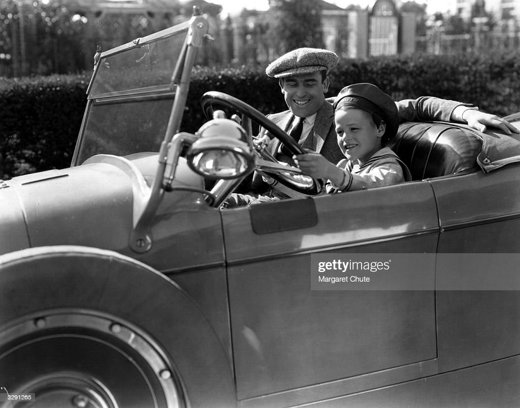 Harold Lloyd teaches a young friend how to drive his car. News ...