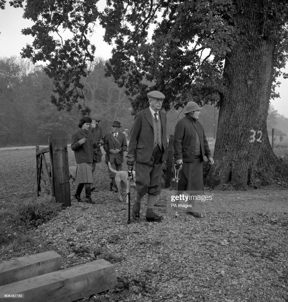 Harold Macmillan, the Prime Minister, walking with Lady Sopwith when